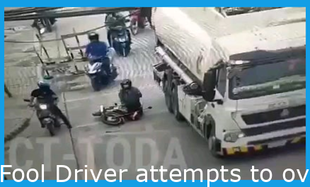 Idiot Driver tries to overtake truck