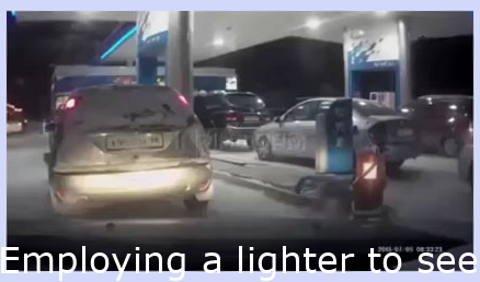 Using a lighter to see the gas pump nozzle